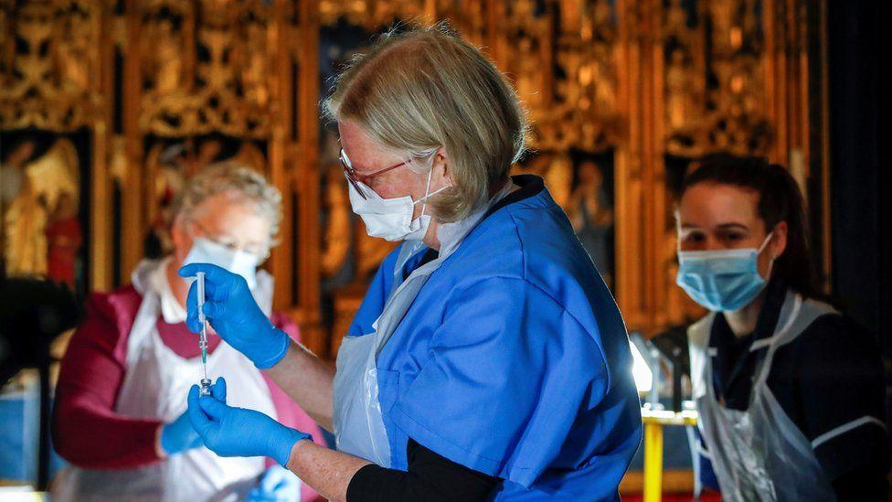 Medics at UK Covid vaccination centre