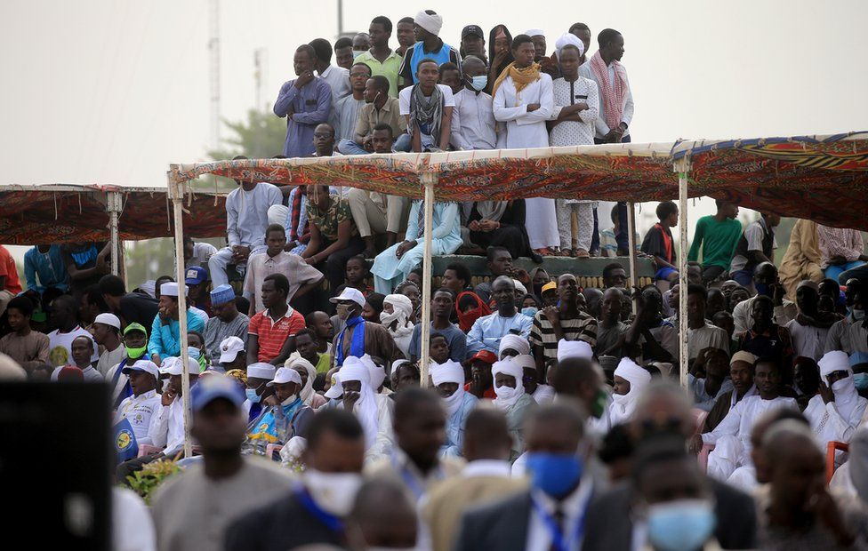 """A crowd gathers to witness the state funeral for the late Chadian president Idriss Deby in N""""Djamena, Chad, 23 April 2021. Chad""""s President Idriss Deby died of injuries suffered in clashes with rebels in the country""""s north, an army spokesperson announced on state television on 20 April 2021. Deby had been in power since 1990 and was re-elected for a sixth term in the 11 April 2021 elections. The state funeral will take place on the morning of 23 April 2021, attended by French President Emmanuel Macron."""