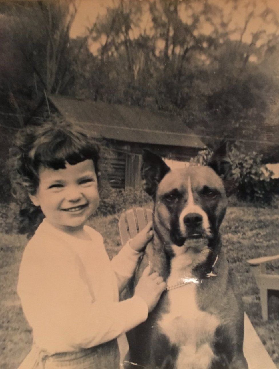 Cat Hulbert as a young girl with canine friend