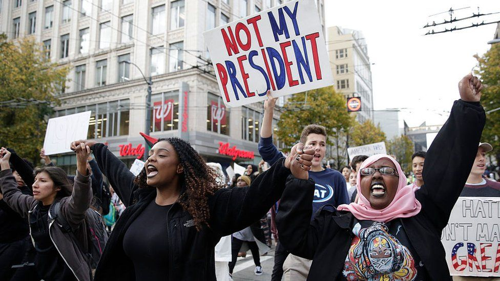 """Protesters chant """"not my president"""" in New York city"""