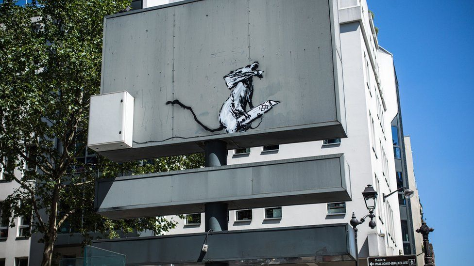 The artwork on the back of a road sign