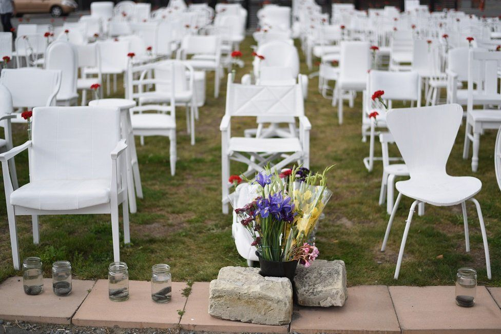 An art installation featuring 185 empty chairs on display in the Botanical Gardens in Christchurch, New Zealand