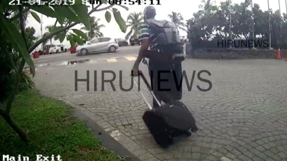 A man believed to be Western-educated bomber Abdul Latheef Mohamed Jameel (in striped shirt and cap) leaves the Taj Samudra hotel in Colombo, Sri Lanka April 21, 2019