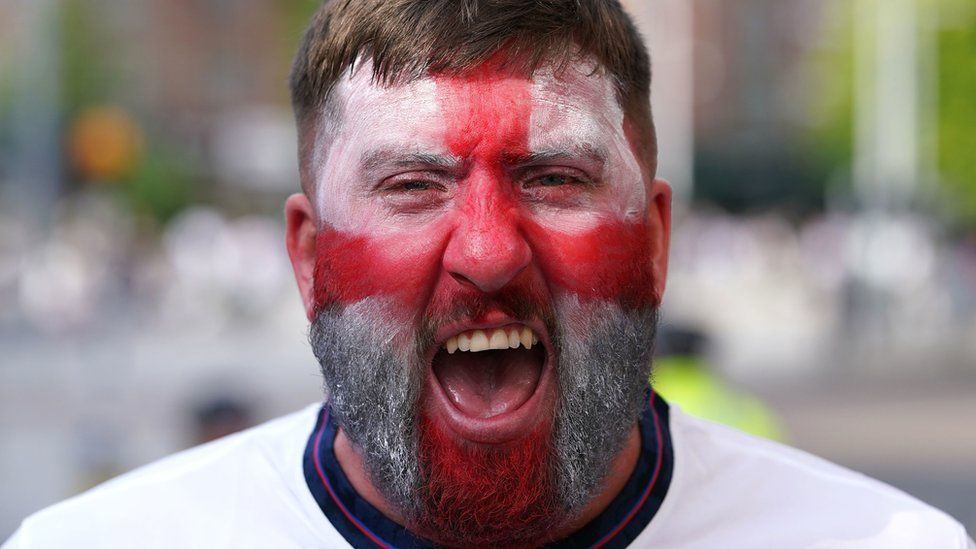 A fan in face paint in Market Square in Nottingham before the Euro2020 quarter final match between England and Ukraine.