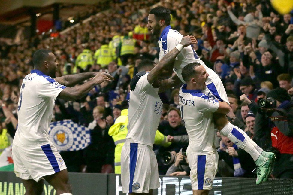 Riyad Mahrez is lifted by his teammates as he celebrates after scoring a goal during the English Premier League soccer match between Watford and Leicester City