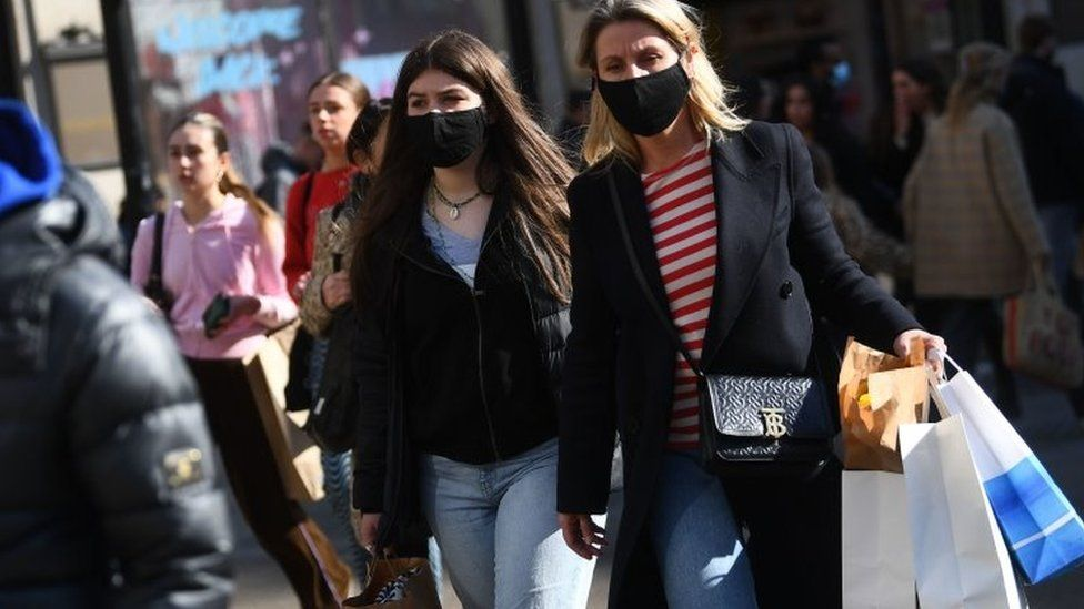 Shoppers wearing masks after lockdown easing