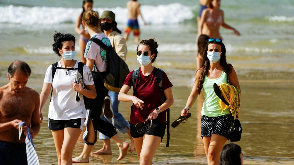 People wear masks at La Concha beach after Spain introduced stricter mask laws during the coronavirus disease (COVID-19) outbreak, in San Sebastian, Spain, March 31, 2021