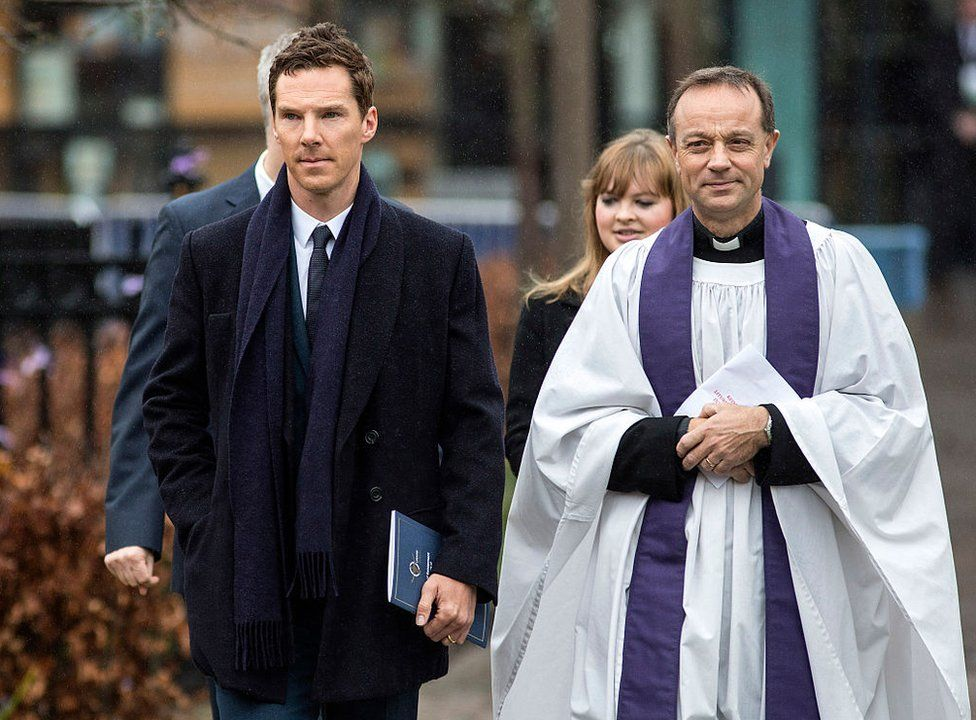 Actor Benedict Cumberbatch (L) and Canon Mike Harrison arrive at Leicester Cathedral for the reinterment ceremony of King Richard III, on March 26, 2015 in Leicester, England.