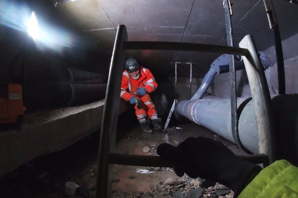 Specialists are working in hollow 'boxes' underneath the road where concrete and steel repairs are taking place