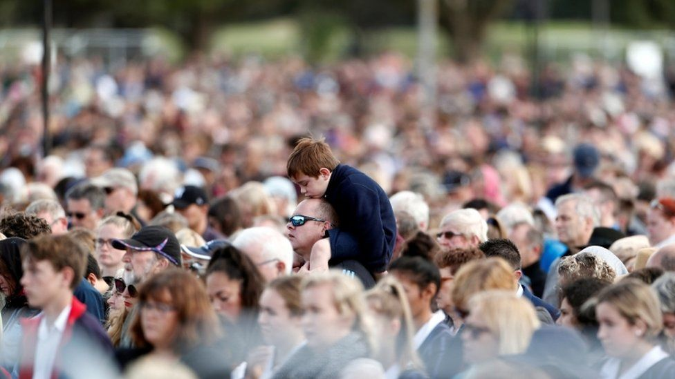 A view of the crowd, including a young boy on his father's shoulders, in Hagley Park on March 29