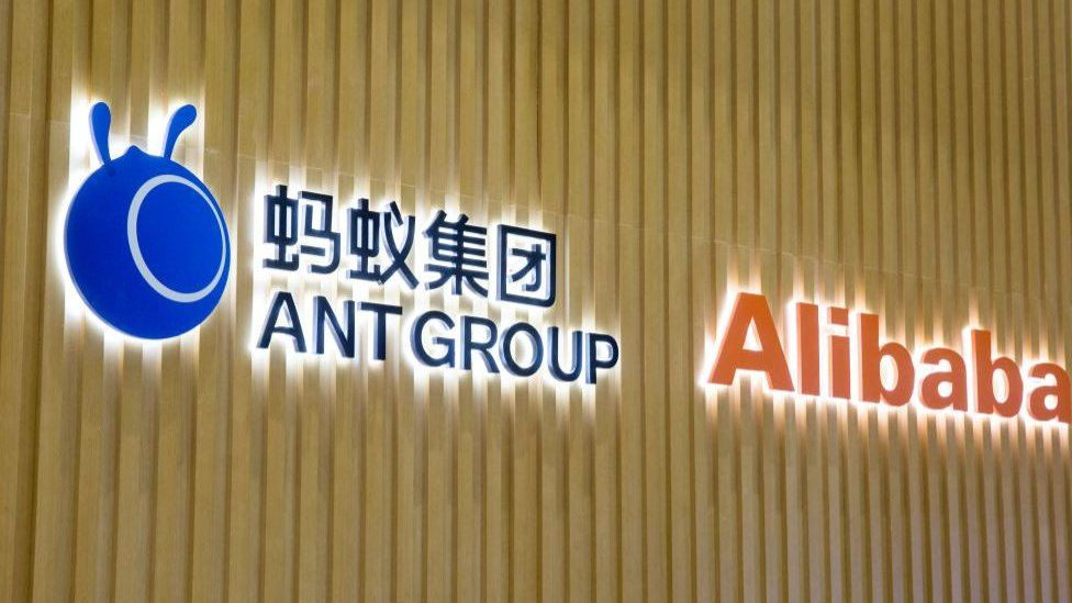 Alibaba and Ant Group logos on a wall