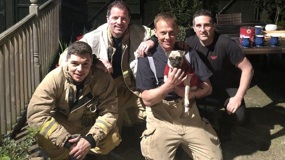 Kiki pictured with the fire crew
