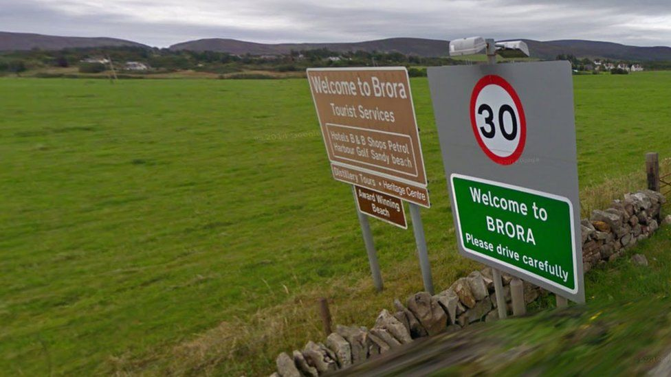 Road signs welcoming motorists to Brora