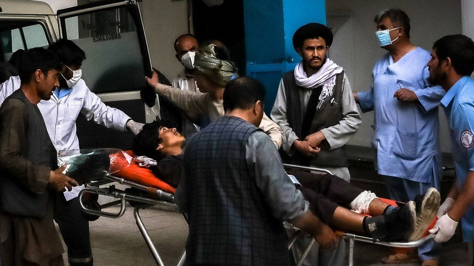People carry an injured man into a hospital after an explosion in downtown Kabul, Afghanistan, 08 May 2021.