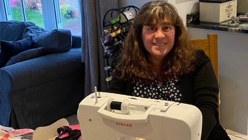 Ruth Smith at a sewing machine