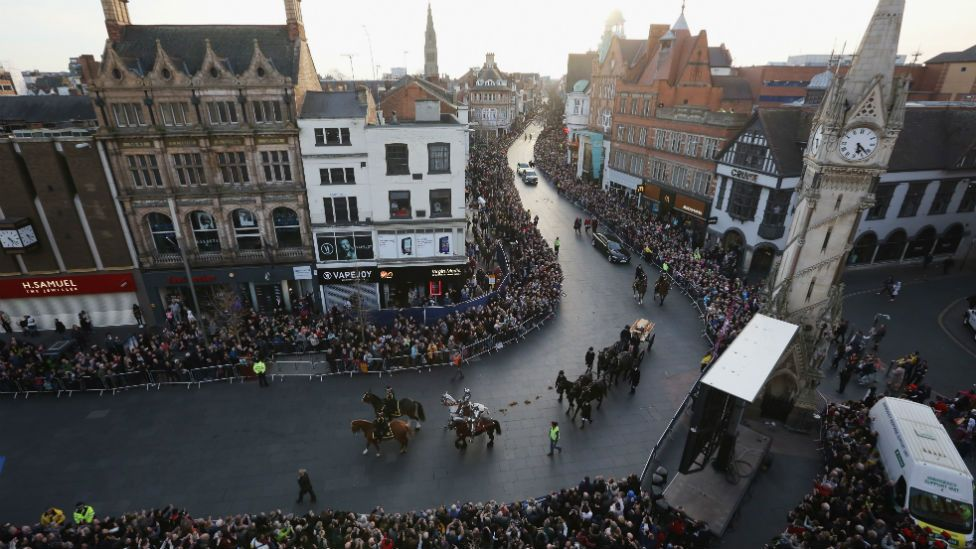 The coffin containing the remains of King Richard III carried through Leicester