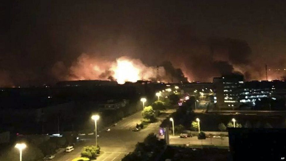 Smoke and fire erupt into the night sky after an explosion in the Binhai area, photo released by Xinhua 12/08/2015