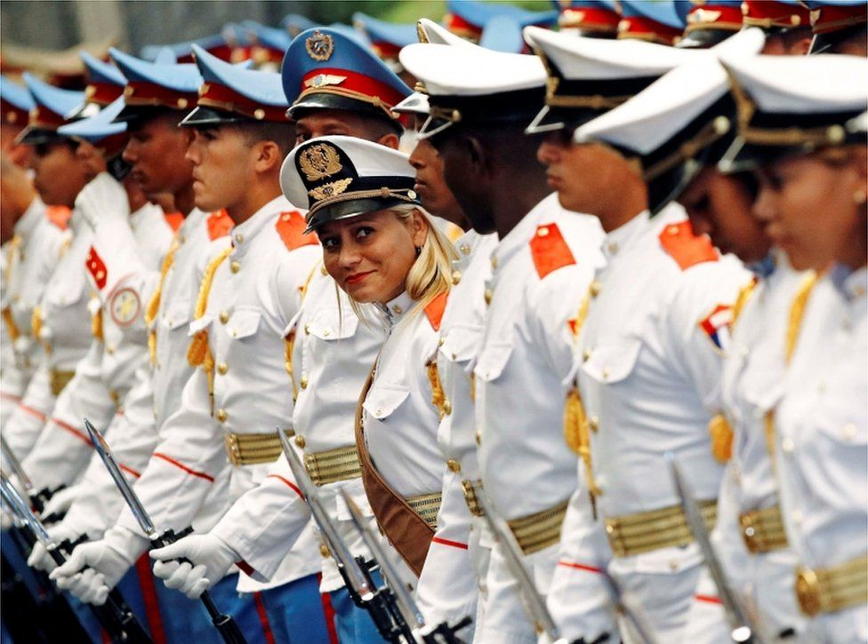 An honour guard stands out as she smiles amongst the other guards