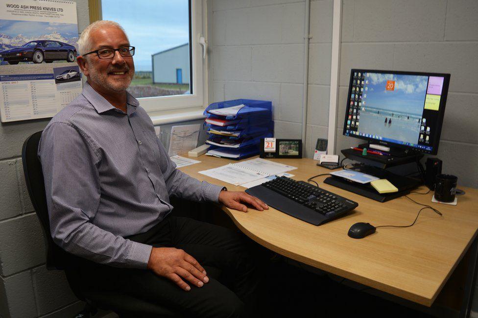Gary at his desk