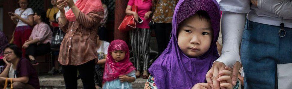 Chinese Hui Muslims gather before Eid al-Fitr prayers