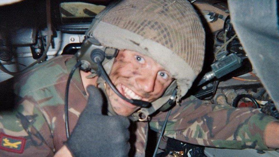 Phil Riding in a British Army bulldog, in Canada in 2009