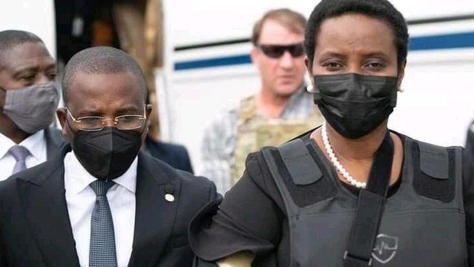 Interim Prime Minister Claude Joseph walks with the Haiti's first lady Martine Moïse