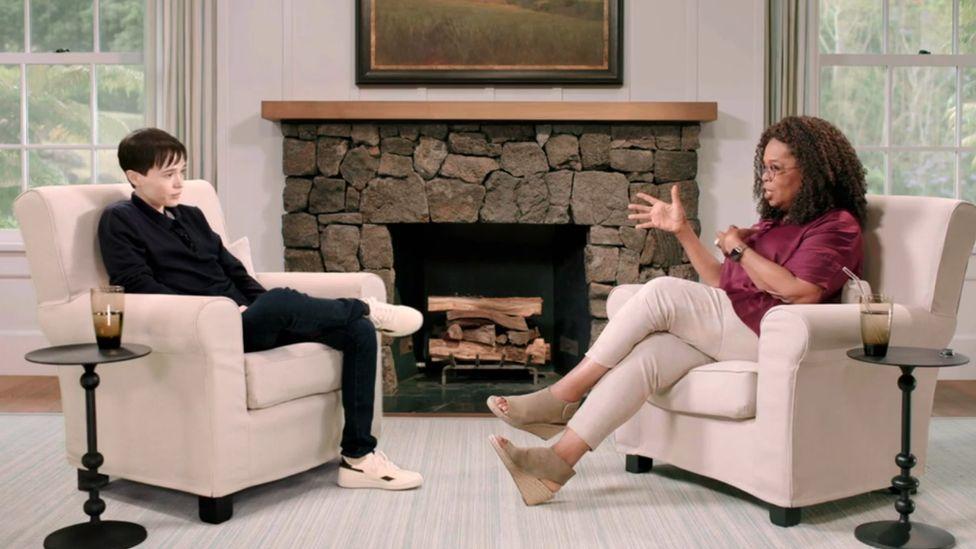 Elliot Page speaking to Oprah Winfrey