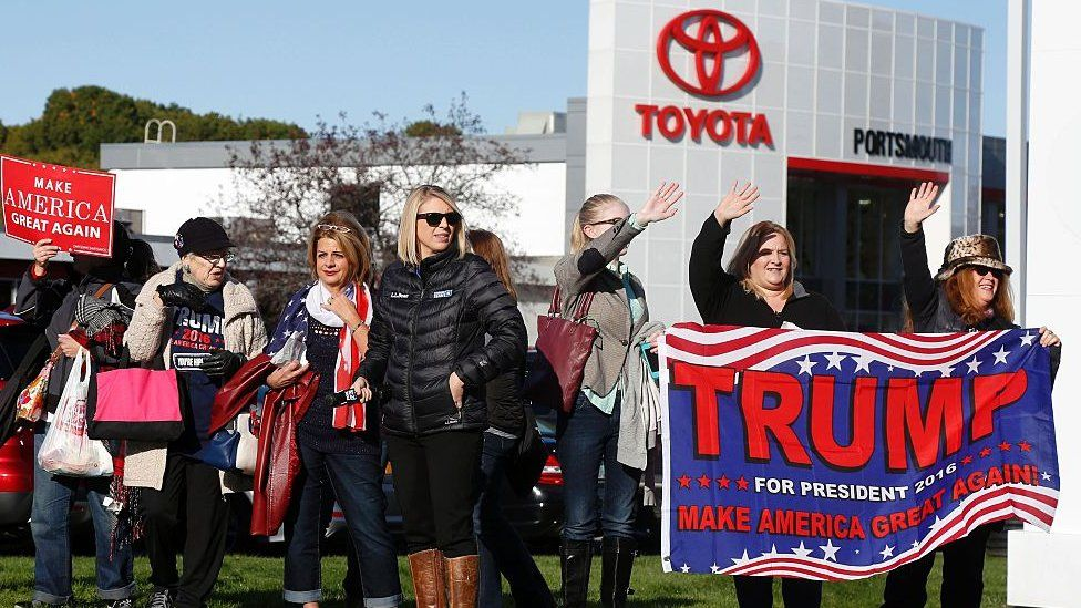 Trump supporters outside a Toyota building