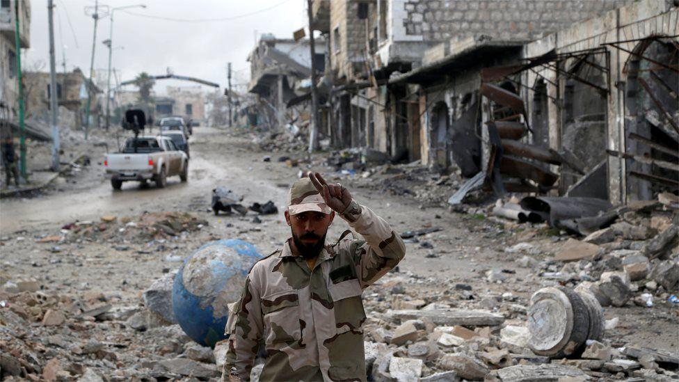 A Syrian army soldier gestures in Maarat al-Numan, Syria (30 January 2020)