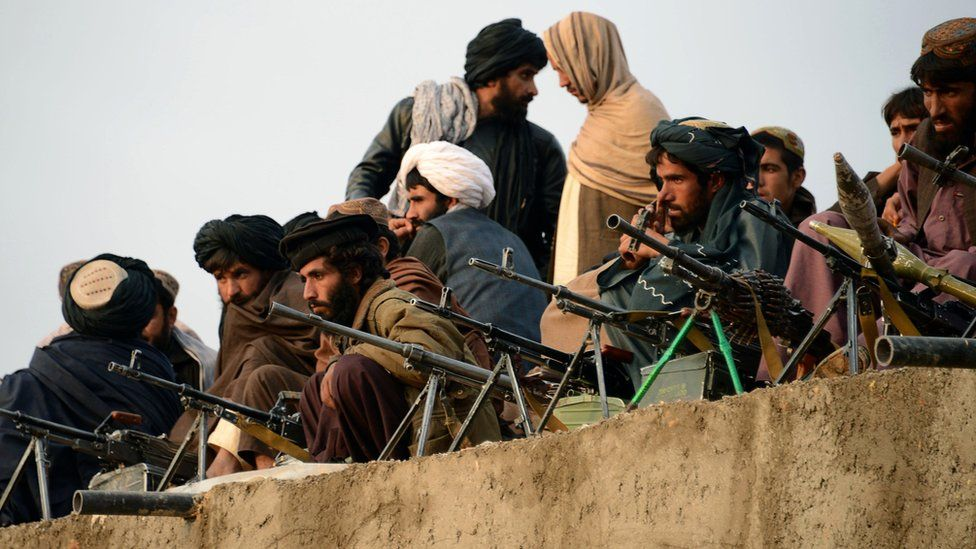 A file picture taken on November 3, 2015, shows Afghan Taliban fighters listening to Mullah Mohammad Rasool Akhund (unseen), the newly appointed leader of a breakaway faction of the Taliban, at Bakwah in the western province of Farah