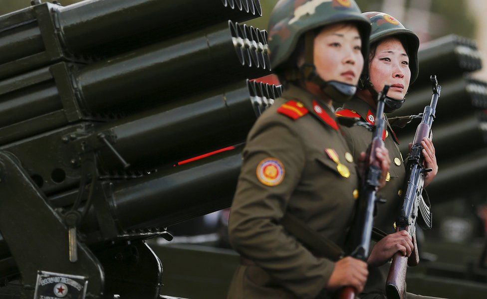 A soldier cries as her vehicle, carrying rocket launchers, takes part in the parade celebrating the 70th anniversary of the founding of the ruling Workers' Party of Korea, in October