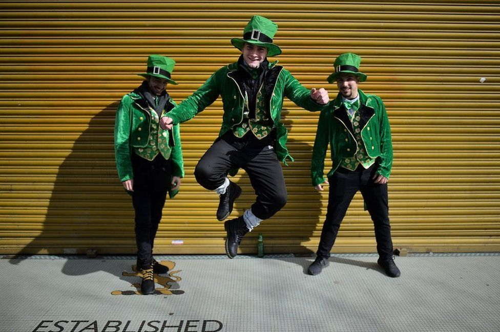 Revellers attend the Saint Patrick's Day parade in Dublin, Ireland.