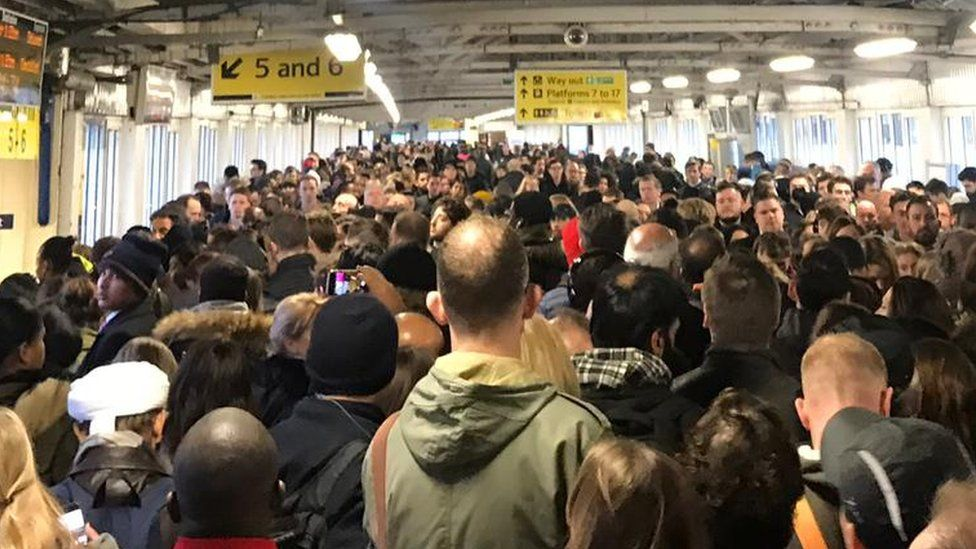 Lots of people bundle into Clapham Junction station