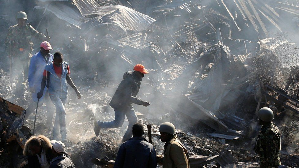 Riot police evict traders at the smouldering scene of fire that gutted Gikomba market, Nairobi, Kenya - 28 June 2018