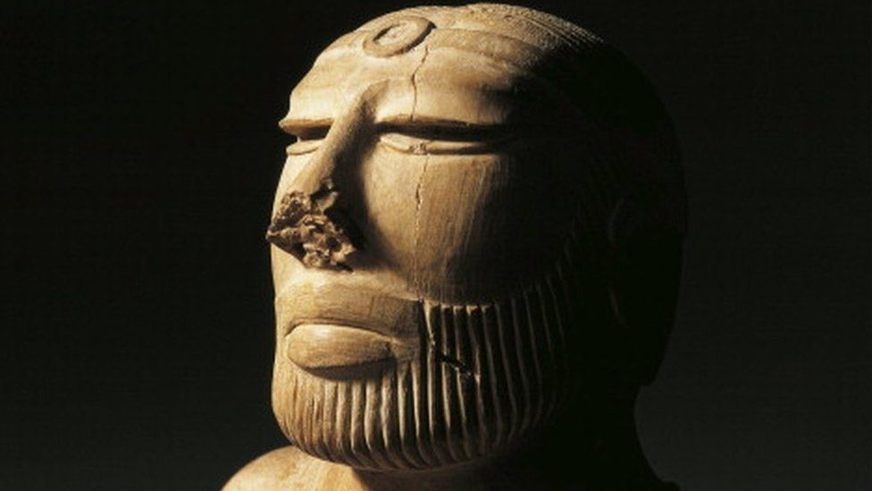 Bust of a Priest King wearing a cloak decorated with clovers, Harappan period, Steatite once coated in pink paste