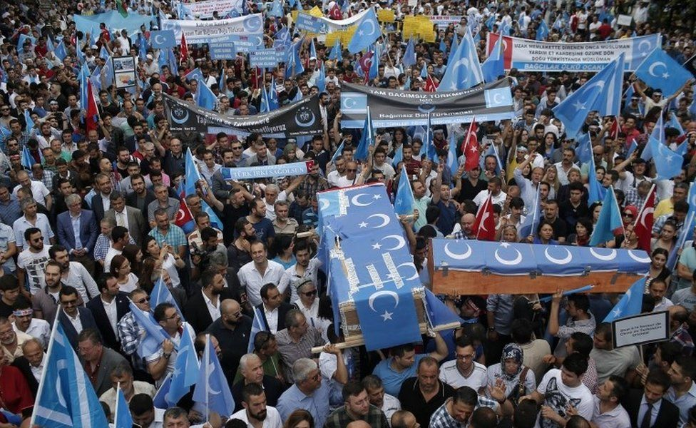 Uighurs living in Turkey and their supporters, some carrying coffins representing Uighurs who died in China's far-western Xinjiang Uighur region, chant slogans