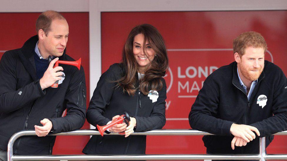 The Duke of Cambridge (left), Prince Harry (right) and the Duchess of Cambridge at the start line of the Virgin Money London Marathon