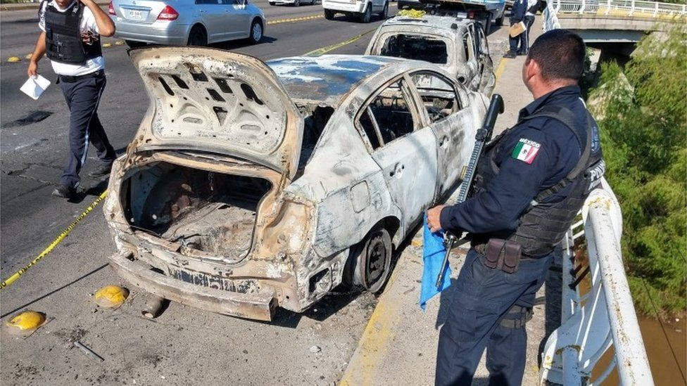 Burned out car after clashes between a drug cartel and Mexican security forces on 18 October 2019