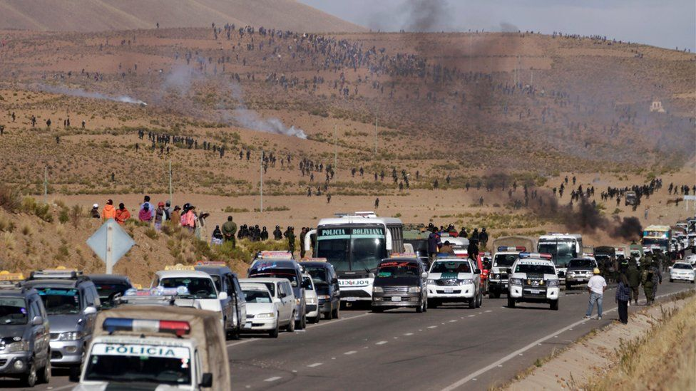 Miners block a highway in Panduro