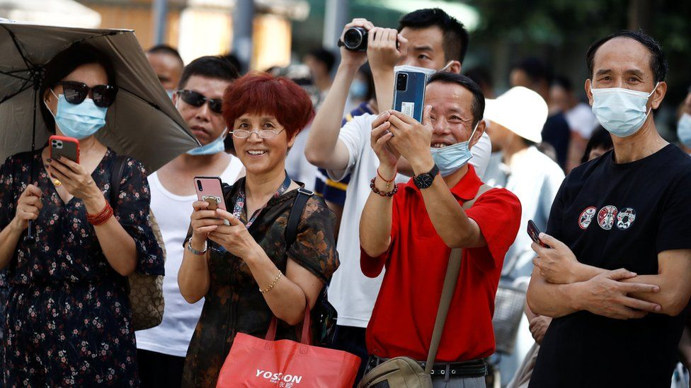People taking pictures with their smartphones