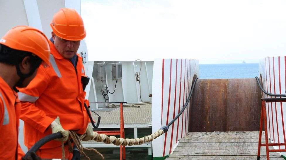 Orange Marine laying cables