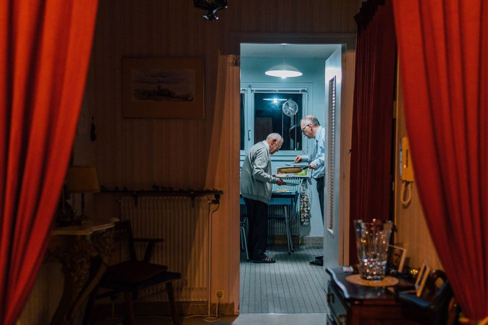 The photographer's father and grandfather cooking together for Christmas