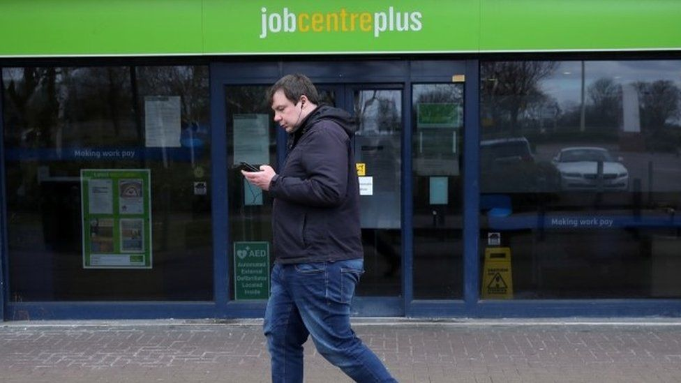 Man walks past job centre
