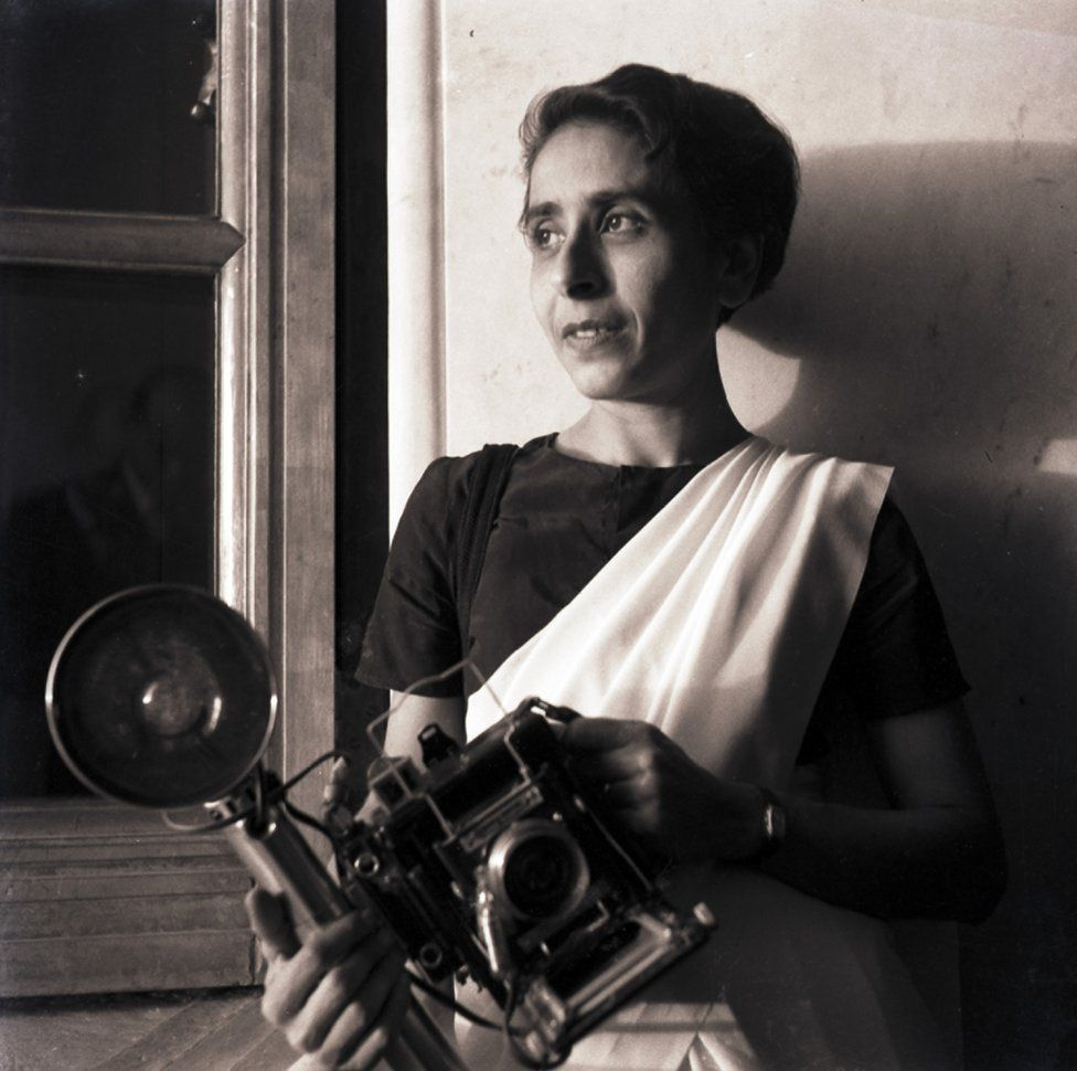 Homai with her speed graphic camera