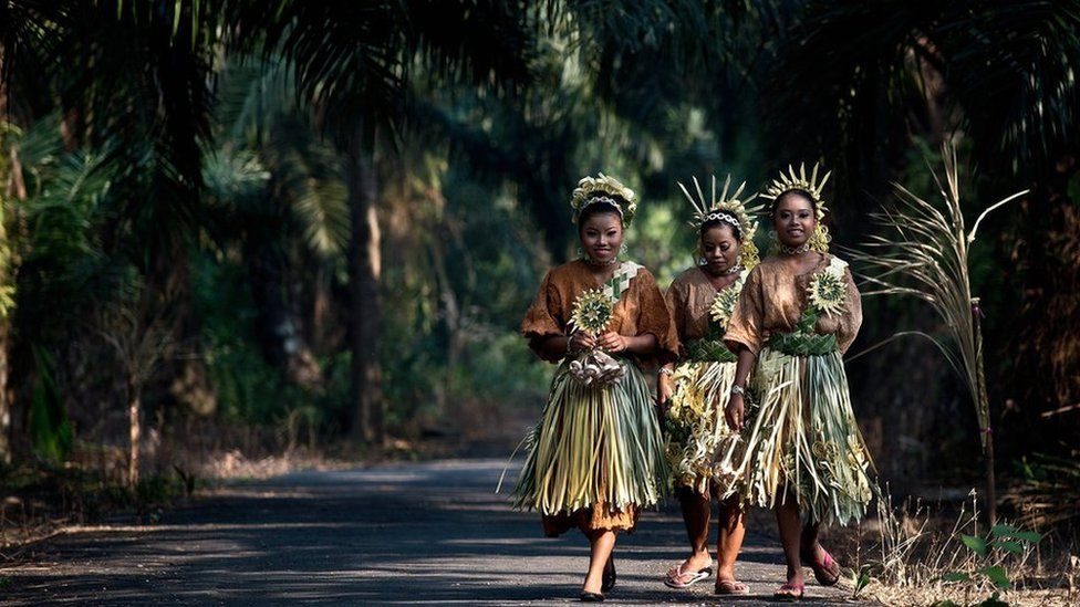 Malaysian women from the indigenous Mah Meri tribe wear traditional costumes on 1 March 2014.