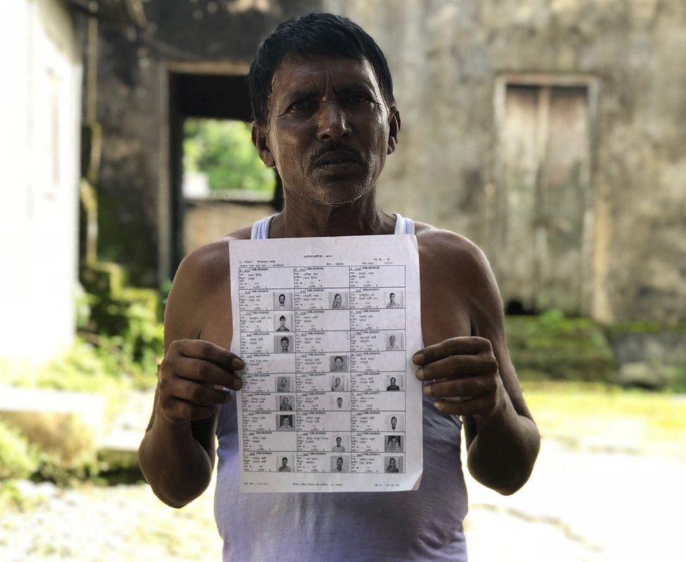 A villager holding up a draft list