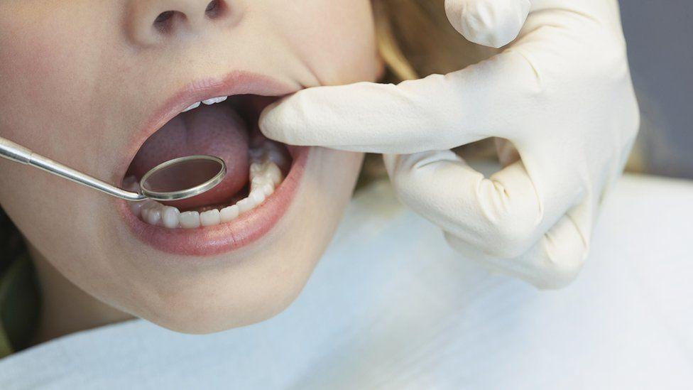 Child being seen by dentist