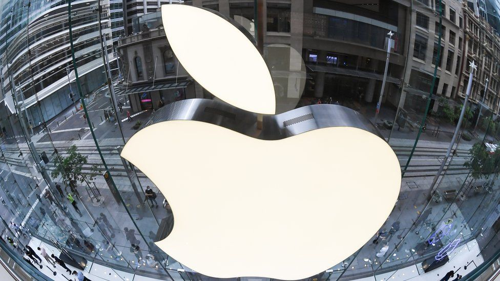 An extreme close-up of the Apple logo on the mirrored surface of the Apple Store on George Street in Sydney, Australia