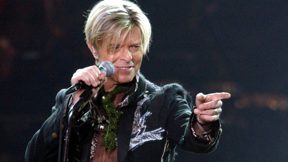 A file photograph showing British rock legend David Bowie performing on stage during his concert in Hamburg, Germany, 16 October 2003