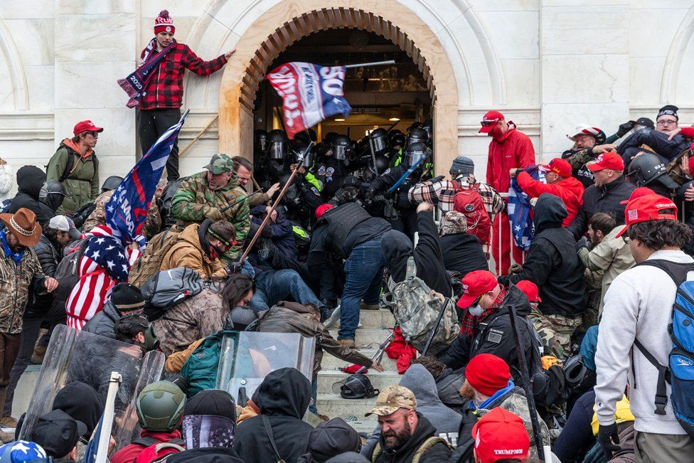 Rioters clash with police while trying to enter the US Capitol building, in Washington, DC. 6 January 2021